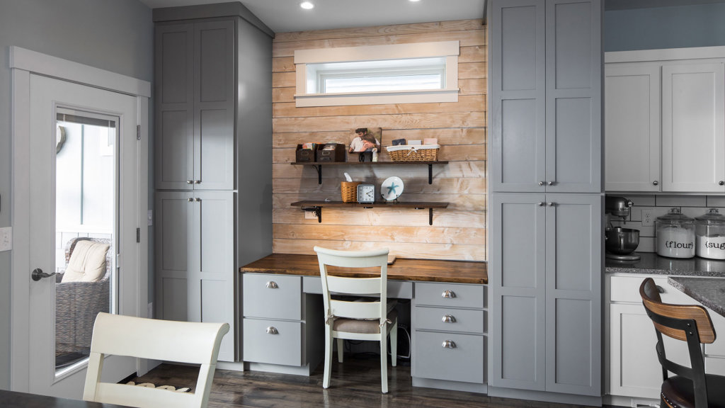 Gray shaker cabinets and wood shiplap in a custom built home office space.