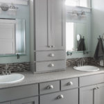 Custom gray shaker cabinets with brushed nickel hardware and mosaic tile in master bathroom.