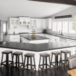 A modern farmhouse kitchen with custom white cabinets, black granite countertops, wood flooring, and barstools.